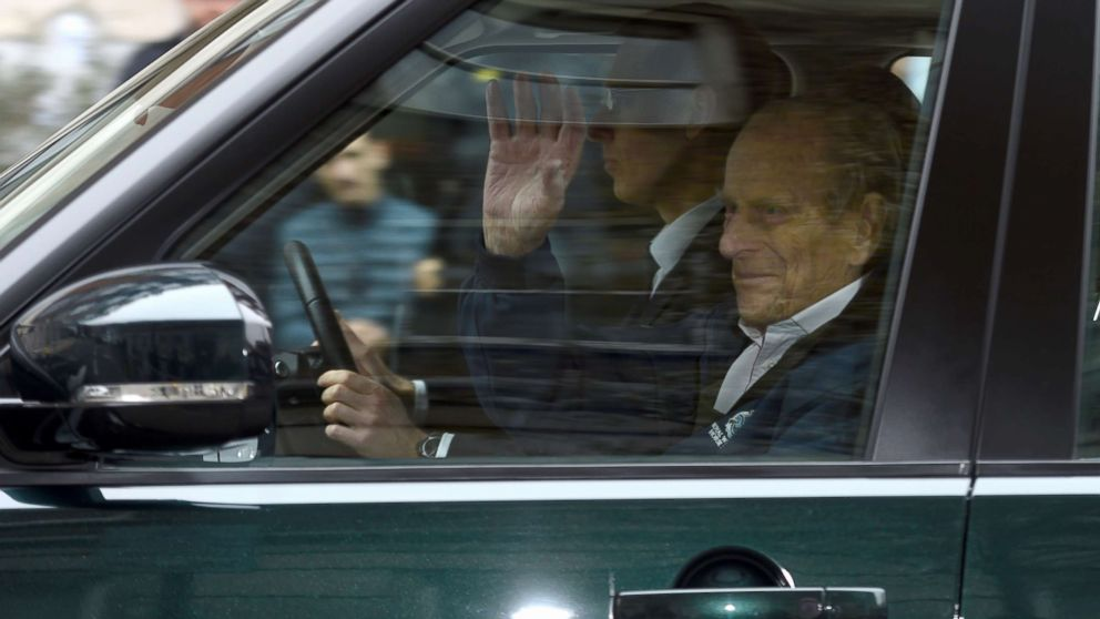 Prince Philip waves as he is driven away from King Edward VII's Hospital in central London, April 13, 2018.