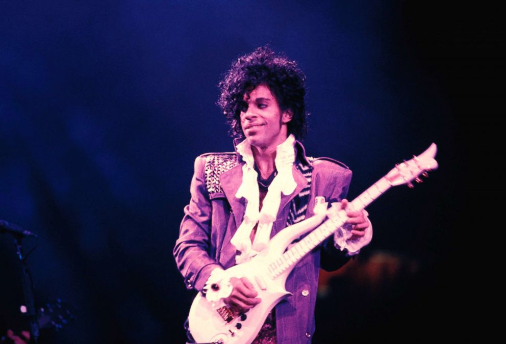 PHOTO: Prince performing on stage during the Purple Rain Tour.