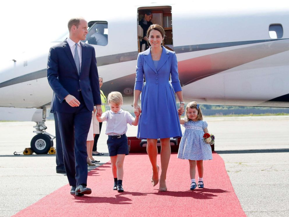 PHOTO: Prince William, Duke of Cambridge, Catherine, Duchess of Cambridge, Prince George of Cambridge and Princess Charlotte of Cambridge arrive at Berlin Tegel Airport during an official visit to Poland and Germany on July 19, 2017 in Berlin.
