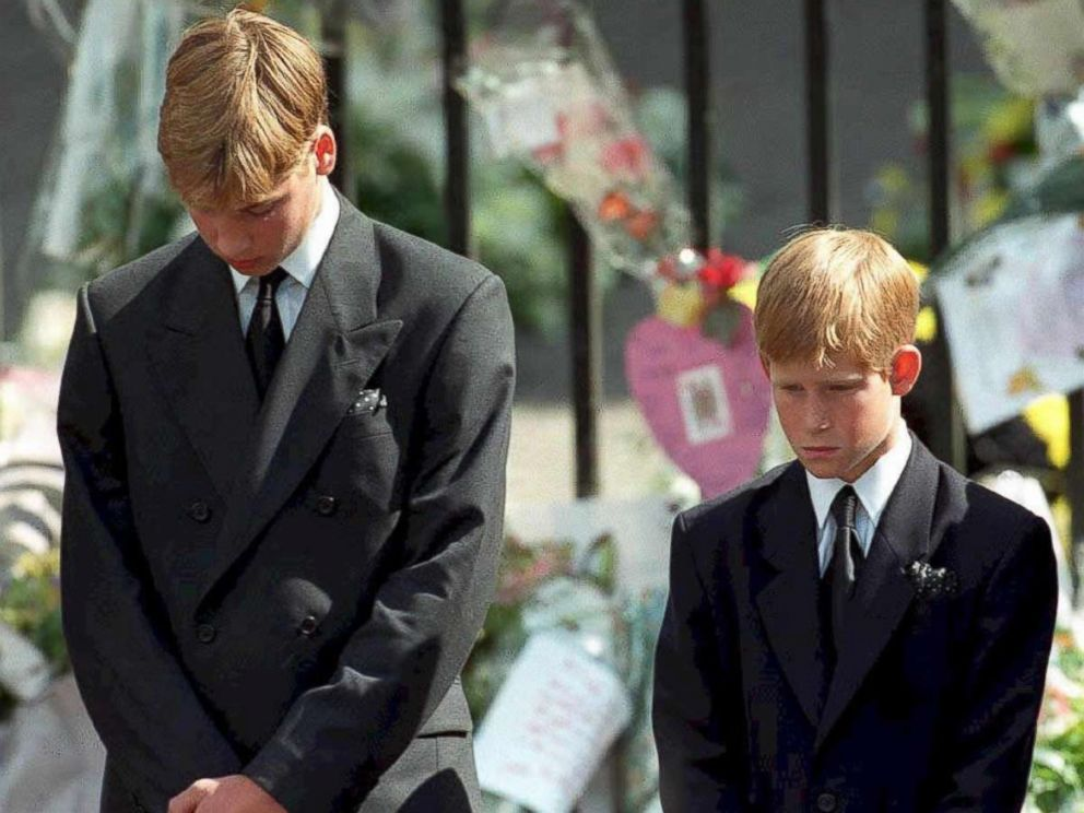 PHOTO: Prince William and Prince Harry, the sons of Diana, Princess of Wales, bowing their heads as their mothers coffin is taken out of Westminster Abbey, following her funeral service, Sept. 6, 1997.
