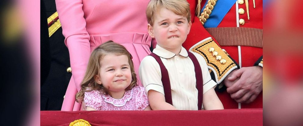 PHOTO: Princess Charlotte of Cambridge and Prince George of Cambridge look on from the balcony during the annual Trooping The Colour parade at the Mall, June 17, 2017, in London.