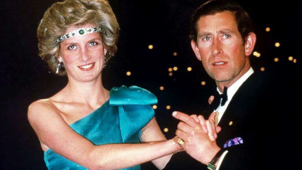 Prince Charles dancing with his wife, Princess Diana, during their official tour of Australia, Oct. 1, 1985, in Melbourne, Australia. The Princess is wearing a diamond and emerald choker (a wedding gift from the Queen) as a headband with a one-shouldered turquoise satin organza dress designed by David And Elizabeth Emanuel.