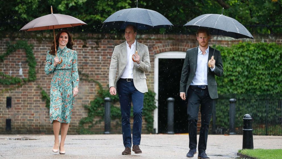 Britain's Prince William, Kate, Duchess of Cambridge and Prince Harry arrive for an event at the memorial garden in Kensington Palace, London, Aug. 30, 2017. Princes William and Harry are paying tribute to their mother, Princess Diana, on the eve of the 20th anniversary of her death by visiting the Sunken Garden to honor Diana's work with charities.