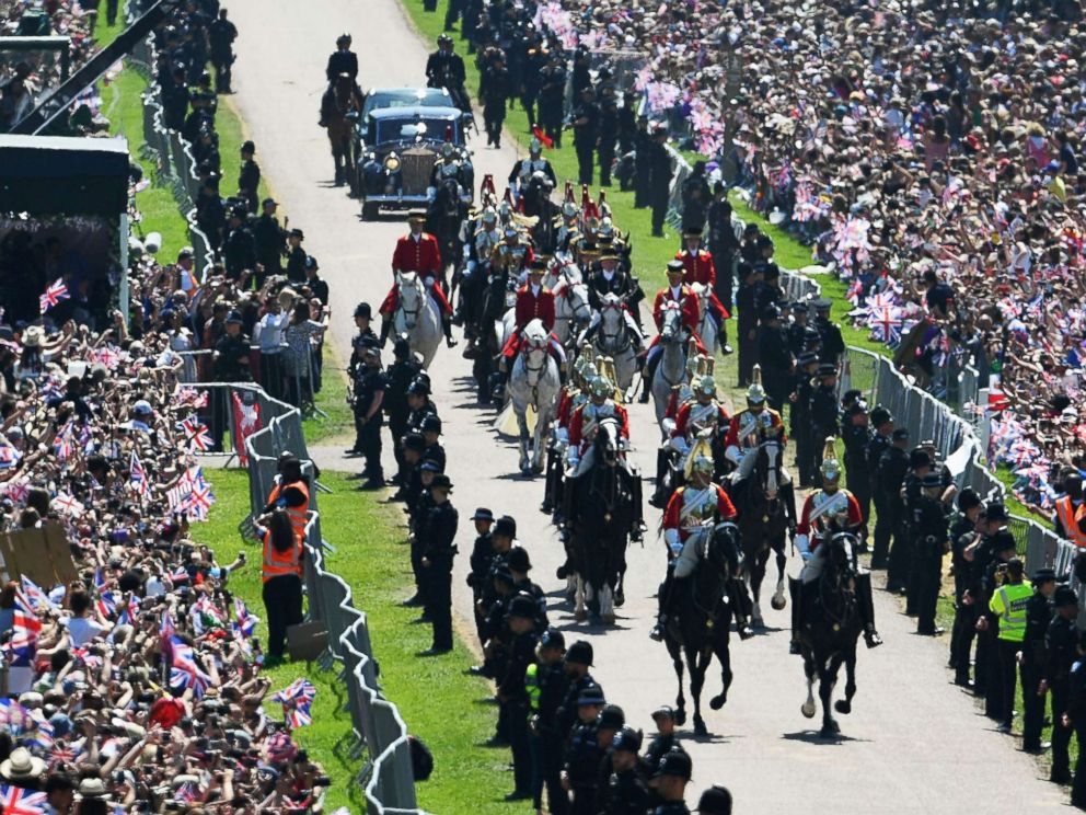 PHOTO: Prince Harry, Duke of Sussex and his wife Meghan, Duchess of Sussex are escorted by members of the Household Cavalry Mounted Regiment during their carriage procession on the Long Walk, May 19, 2018.