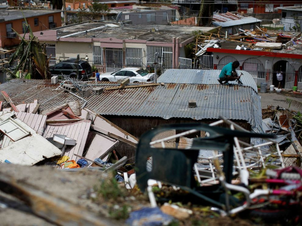 PHOTO: A man tries to rebuild his house after the area was hit by Hurricane Maria in Canovanas, Puerto Rico, Sept. 26, 2017.