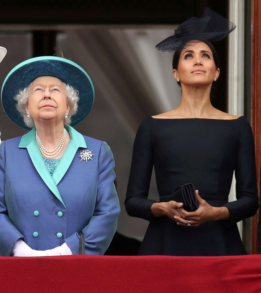 PHOTO: Britains Queen Elizabeth and Meghan Markle, Duchess of Sussex stand on the balcony of Buckingham Palace as they watch a fly past to mark the centenary of the Royal Air Force in central London, July 10, 2018.