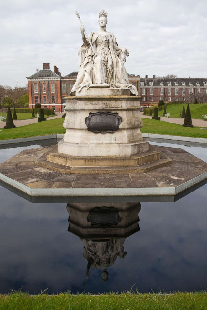PHOTO: A statue of Queen Victoria stands behind Kensington Palace in Kensington Gardens, April 19, 2016, in London.