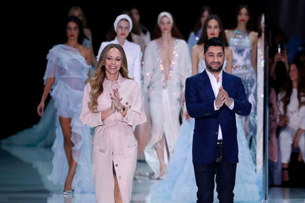 PHOTO: Fashion designers Michael Russo (R) and Tamara Ralph (L) for Ralph & Russo acknowledge the audience after the Ralph & Russos fashion show during the 2018 spring/summer Haute Couture collection fashion show, Jan. 22, 2018, in Paris.