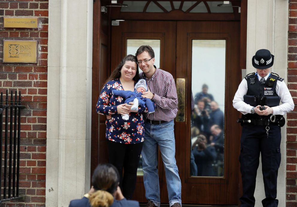 PHOTO: A couple pose for a photo with their newborn baby as they leave the Lindo wing at St Marys Hospital in London, April 23, 2018.
