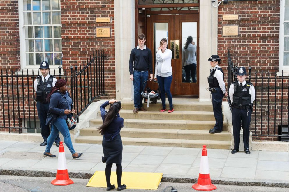 PHOTO: A couple with their newborn baby pose for photos outside the Lindo Wing at St Marys Hospital, London, April 23, 2018.
