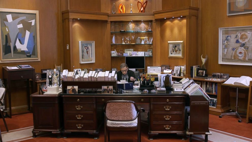 PHOTO: Associate Justice of the Supreme Court Ruth Bader Ginsburg works in an office in a scene from the movie, RBG.