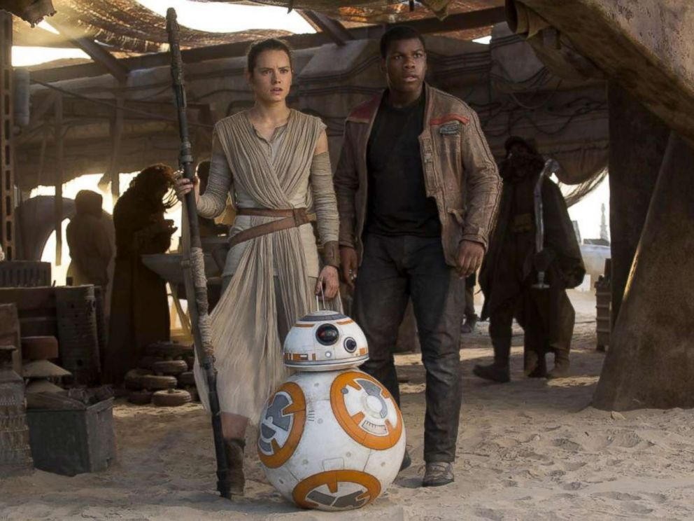 PHOTO: Daisy Ridley, left, as Rey, and John Boyega, as Finn, in a scene from Star Wars: The Force Awakens.
