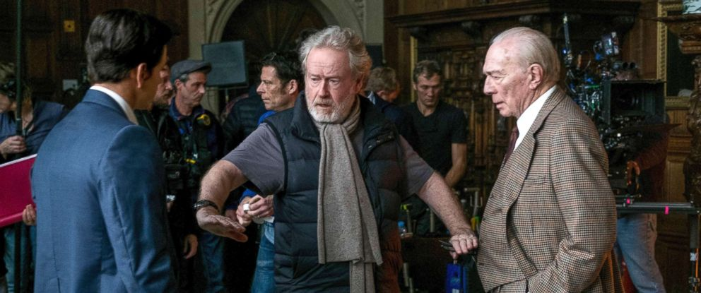 "PHOTO: Mark Wahlberg, left, and Christopher Plummer, right, listening to director Ridley Scott on the set of ""All The Money In The World."""