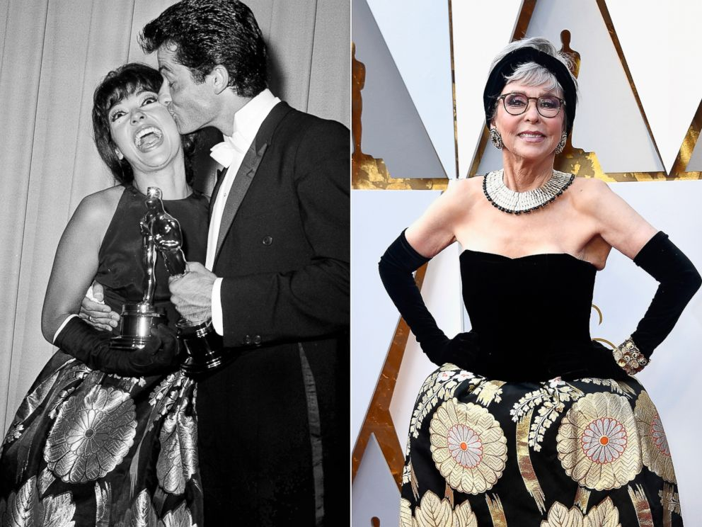 PHOTO: Rita Moreno wears the same dress to the Oscars in 1962, pictured getting a kiss from George Chakiris, and on the red carpet in 2018, right.
