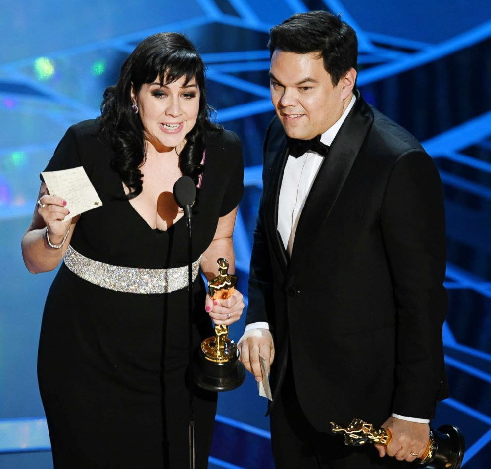 PHOTO: Kristen Anderson-Lopez and Robert Lopez accept best original song award for Remember Me from Coco during the Academy Awards on March 4, 2018, in Hollywood, Calif.
