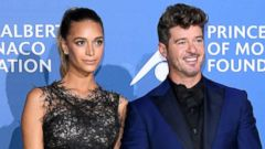 "PHOTO: Robin Thicke and April Love Geary attend the inaugural ""Monte-Carlo Gala for the Global Ocean"" honoring Leonardo DiCaprio at the Monaco Garnier Opera, Sept. 28, 2017 in Monaco."