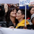 Actresses Asia Argento, left, and Rose McGowan pose during a demonstration to mark the international Women's Day in Rome, March 8, 2018.