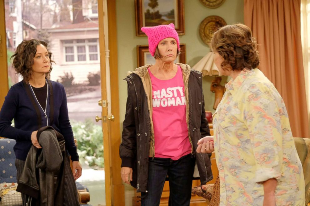 Metcalf and Roseanne Barr appear in a scene from Roseanne