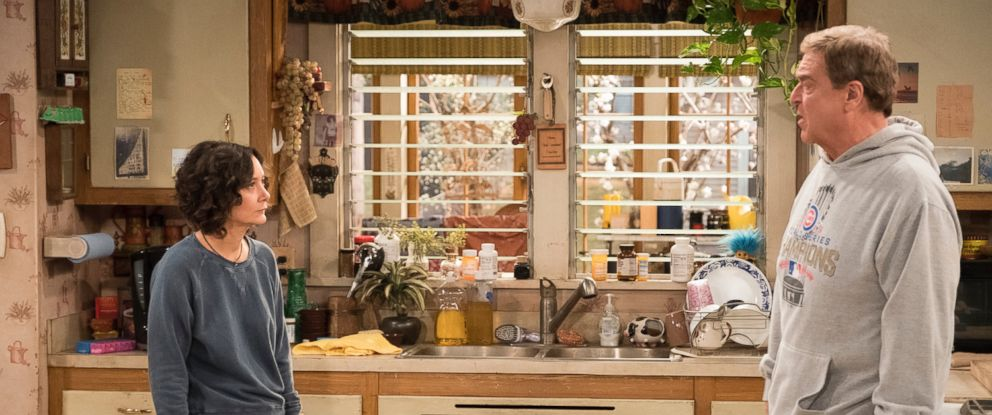 "PHOTO: Sara Gilbert and John Goodman on the eighth episode of the revival of ""Roseanne,"" which aired on May 15, 2018 on ABC."