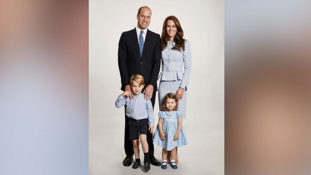 Britain's Prince William and Kate, the Duchess of Cambridge pose with their children Prince George and Princess Charlotte, at Kensington Palace in this undated photo provided by Kensington Palace. The photo has been used on the Cambridges' Christmas card.