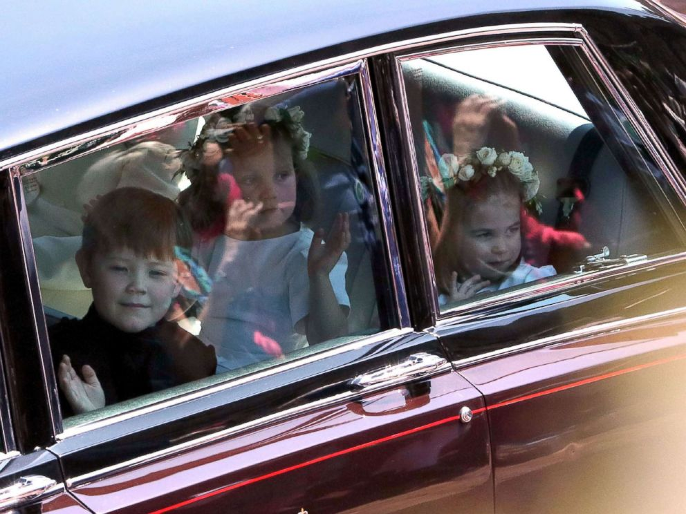 PHOTO: Princess Charlotte arrive for the wedding ceremony of Britains Prince Harry and Meghan Markle at St Georges Chapel at Windsor Castle in Windsor, May 19, 2018.