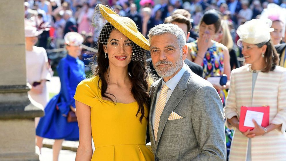 Amal and George Clooney arrive at St George's Chapel at Windsor Castle before the wedding of Prince Harry to Meghan Markle on May 19, 2018 in Windsor.