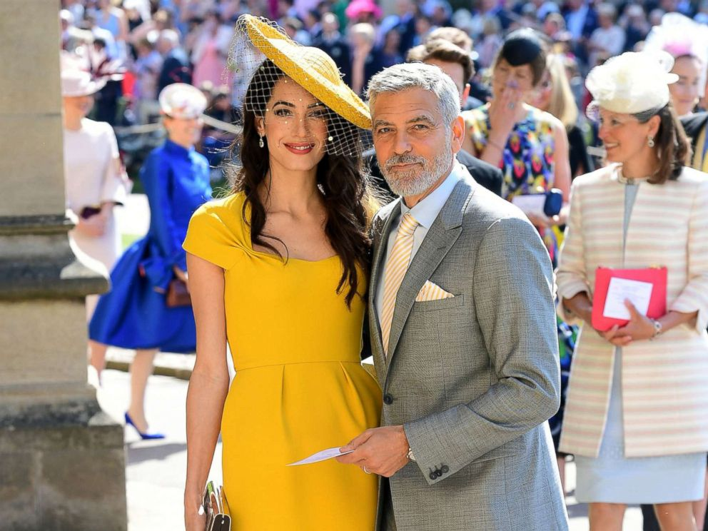 PHOTO: Amal and George Clooney arrive at St Georges Chapel at Windsor Castle before the wedding of Prince Harry to Meghan Markle on May 19, 2018 in Windsor.