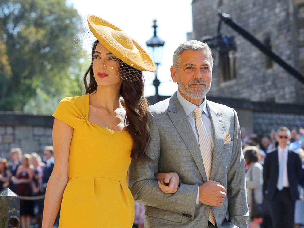 PHOTO: Amal Clooney and George Clooney arrive for the wedding ceremony of Prince Harry and Meghan Markle at St. Georges Chapel in Windsor Castle in Windsor, May 19, 2018.