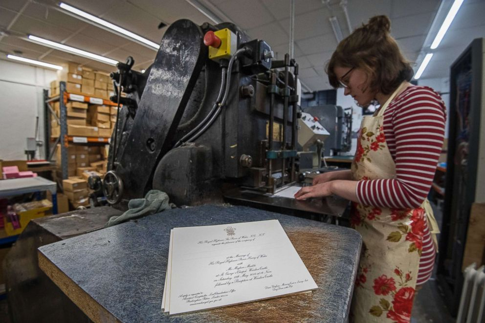 PHOTO: Lottie Small uses the die stamping press at the workshop of Barnard and Westwood in London, the company is printing the invitations for Prince Harry and Meghan Markles upcoming wedding, March 22, 2018.