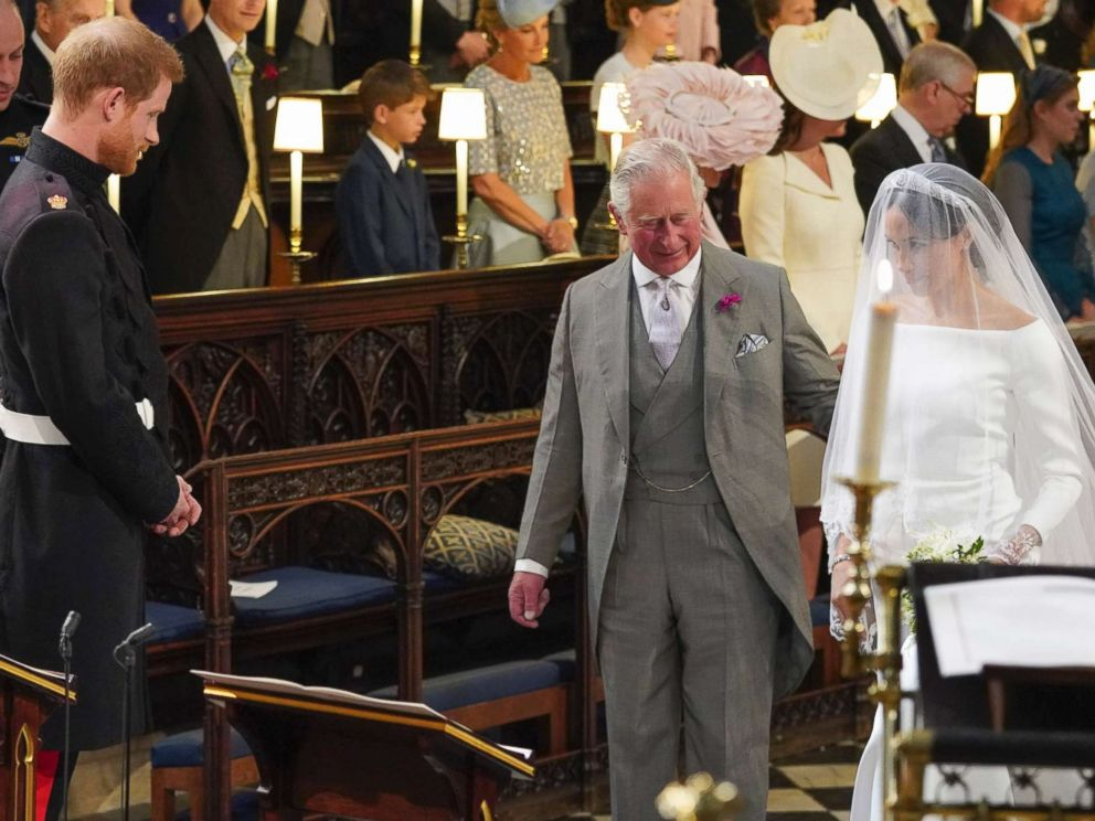 PHOTO: Prince Harry looks at his bride, Meghan Markle, as she arrives accompanied by Charles, the Prince of Wales, in St Georges Chapel at Windsor Castle for their wedding, May 19, 2018.