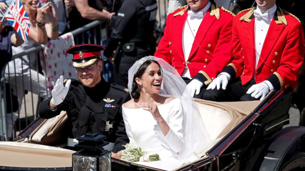 Prince Harry and his wife Meghan ride a horse-drawn carriage after their wedding ceremony at St George's Chapel in Windsor Castle in Windsor, May 19, 2018.