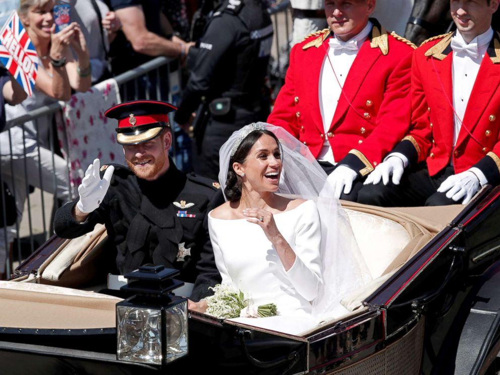 PHOTO: Prince Harry and his wife Meghan ride a horse-drawn carriage after their wedding ceremony at St Georges Chapel in Windsor Castle in Windsor, May 19, 2018.