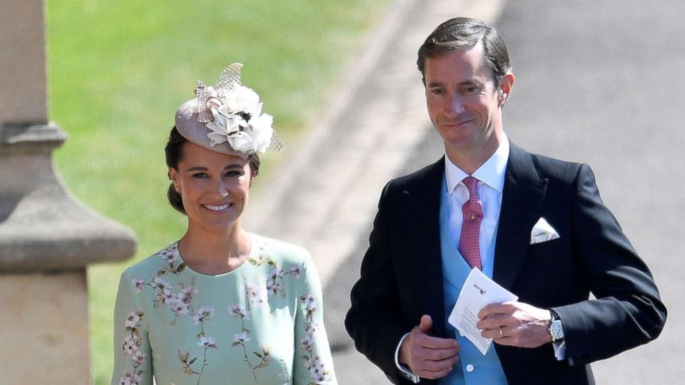 Pippa Middleton arrives with her husband James Matthews to the wedding of Prince Harry and Meghan Markle in Windsor, May 19, 2018.