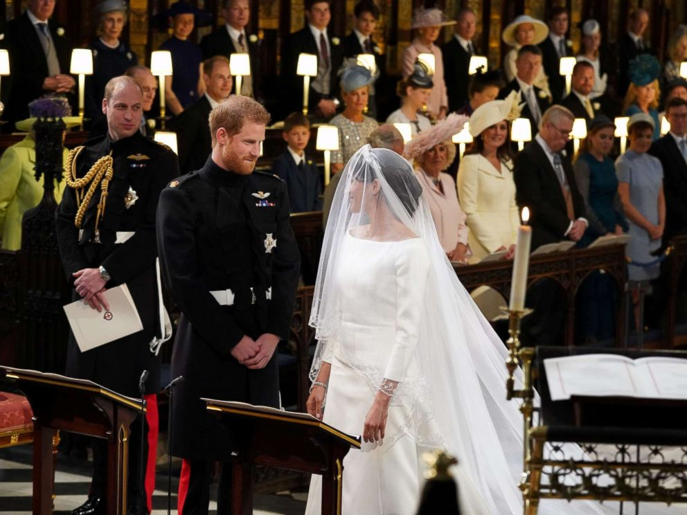 PHOTO: Prince Harry looks at his bride, Meghan Markle, as she arrives in St Georges Chapel at Windsor Castle for their wedding in Windsor, Britain, May 19, 2018.
