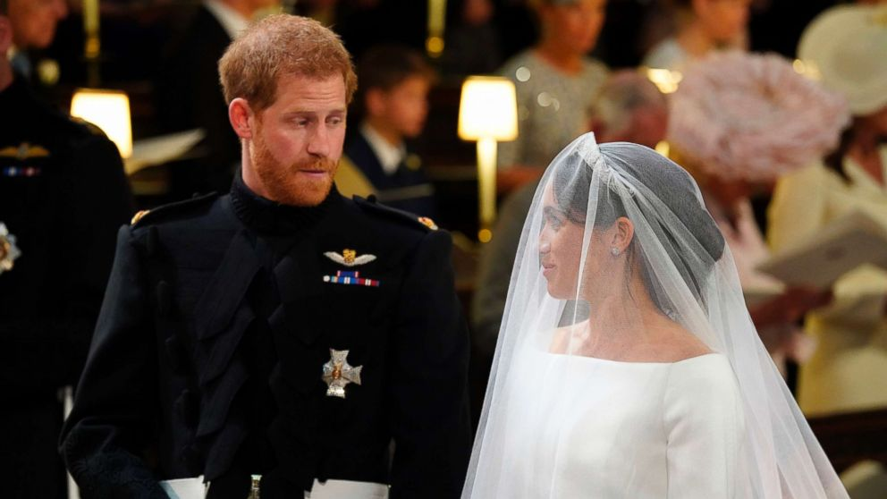 read what prince harry and meghan markle said in their wedding vows abc news prince harry and meghan markle said