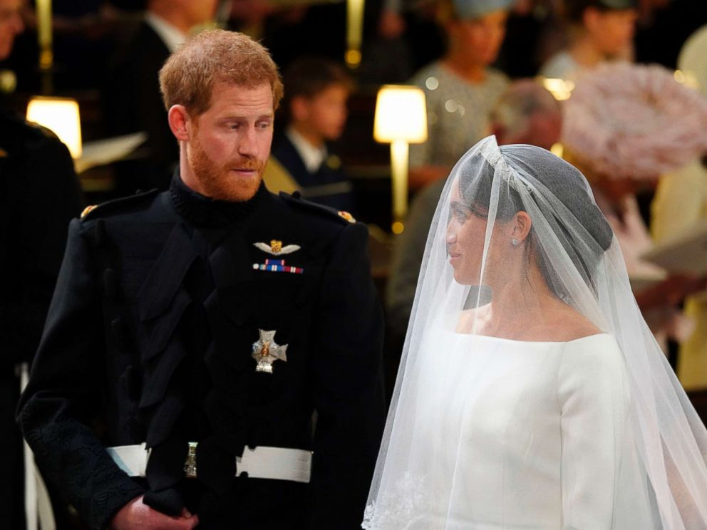 PHOTO: Prince Harry looks at his bride, Meghan Markle, during their wedding ceremony at St. Georges Chapel in Windsor Castle in Windsor, May 19, 2018.