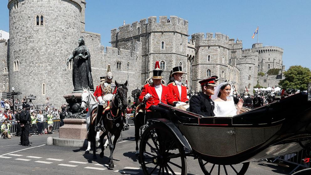 Prince Harry, Duke of Sussex and The Duchess of Sussex leave Windsor Castle in the Ascot Landau carriage during a procession after getting married at St Georges Chapel on May 19, 2018 in Windsor.