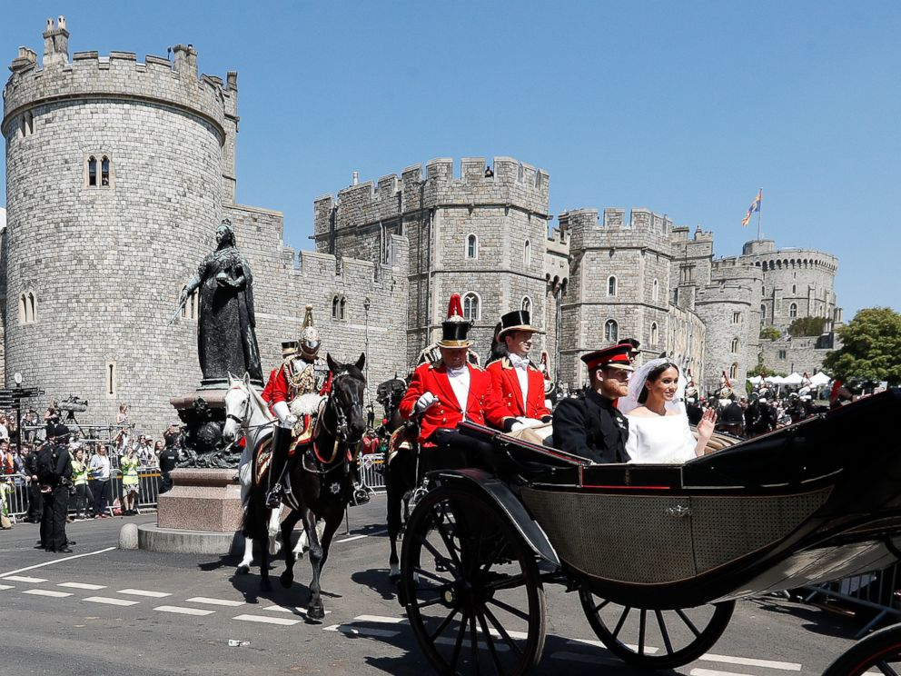 PHOTO: Prince Harry, Duke of Sussex and The Duchess of Sussex leave Windsor Castle in the Ascot Landau carriage during a procession after getting married at St Georges Chapel on May 19, 2018 in Windsor.