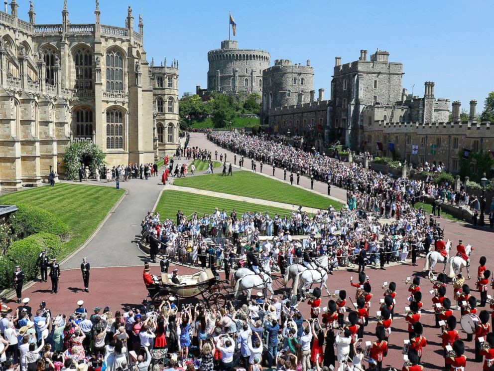 PHOTO: Prince Harry, Duke of Sussex and Meghan, The Duchess of Sussex, leave Windsor Castle in the Ascot Landau carriage during a procession after getting married at St Georges Chapel on May 19, 2018 in Windsor.