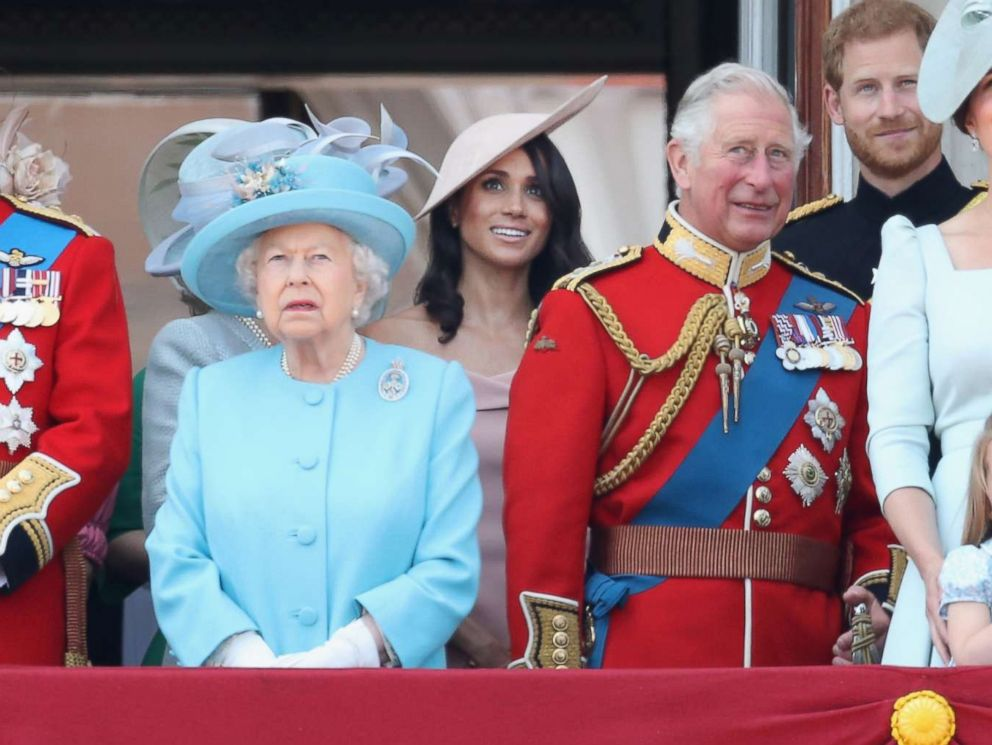 PHOTO: The royal family, including Queen Elizabeth II and Meghan, Duchess of Sussex, watch the flypast on the balcony of Buckingham Palace during Trooping The Colour on June 9, 2018 in London.