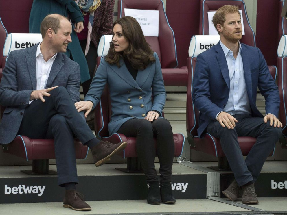 PHOTO: Britains Prince William, Duke of Cambridge and Britains Catherine, Duchess of Cambridge share a light moment as Britains Prince Harry looks on during their visit to attend the graduation ceremony, in east London, Oct. 18, 2017.