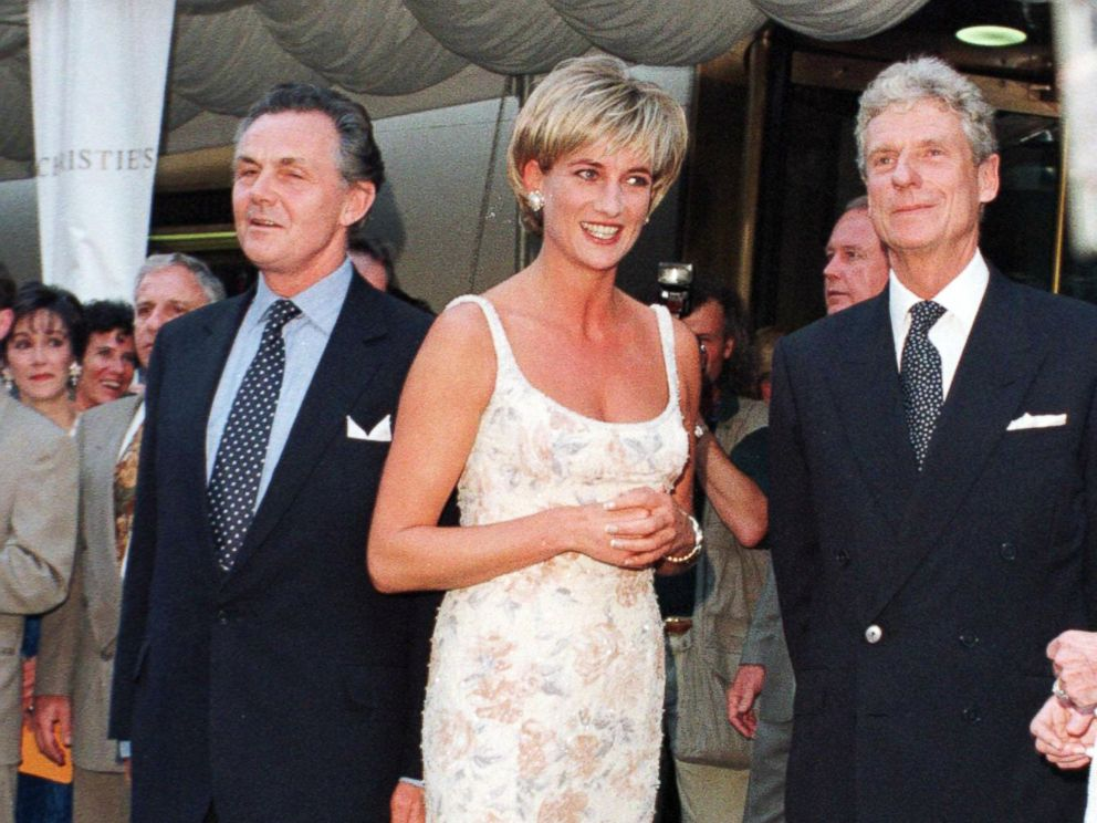 PHOTO: Princess Diana poses for photographs with Lord Hindlip, Chairman of Christies International and Christopher Bafour Chairman of Christies Europe at Christies auction house in New York on June 23, 1997.