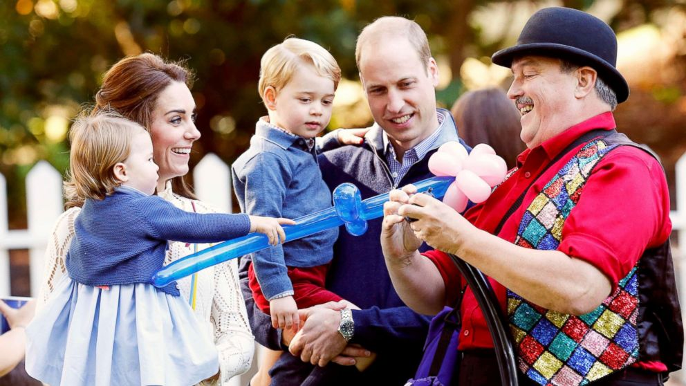 Britain's Princess Charlotte, Catherine, Duchess of Cambridge, Prince George and Prince William, watch as a man inflates balloons at a children's party at Government House in Victoria, British Columbia, Canada, Sept. 29, 2016.