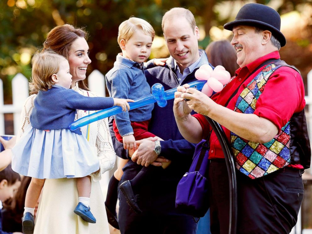 PHOTO: Britains Princess Charlotte, Catherine, Duchess of Cambridge, Prince George and Prince William, watch as a man inflates balloons at a childrens party at Government House in Victoria, British Columbia, Canada, Sept. 29, 2016.