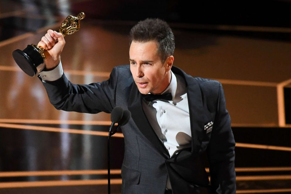 PHOTO: Sam Rockwell accepts the Oscar for performance by an actor in a supporting role for Three Billboards outside Ebbing, Missouri during the 90th Academy Awards at the Dolby Theatre.