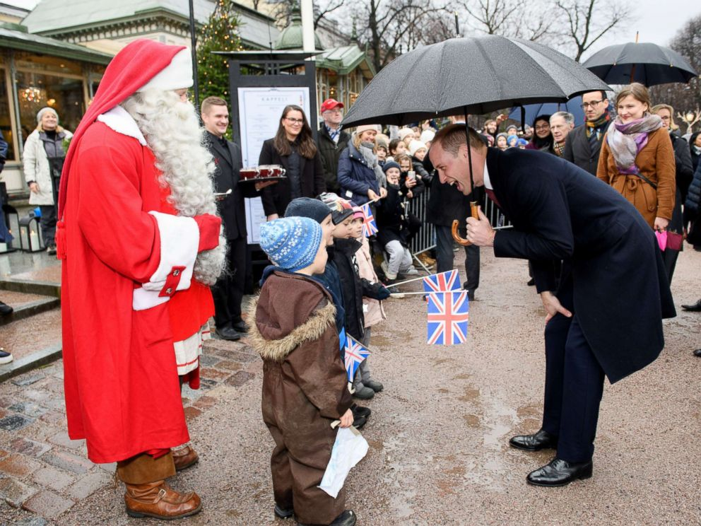 PHOTO: Prince William gives a Christmas list from Prince George to Santa Claus at Esplanade Parks Christmas market in Helsinki, Nov. 30, 2017.