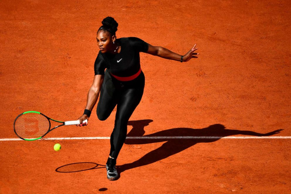 PHOTO: Serena Williams plays a forehand return to Czech Republics Kristyna Pliskova during their womens singles first round match on day three of The Roland Garros 2018 French Open tennis tournament in Paris, May 29, 2018.