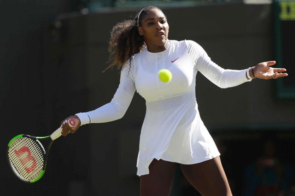 PHOTO: Serena Williams returns a ball to Arantxa Rus of the Netherlands during the Womens Singles first round match at the Wimbledon Tennis Championships in London, July 2, 2018.