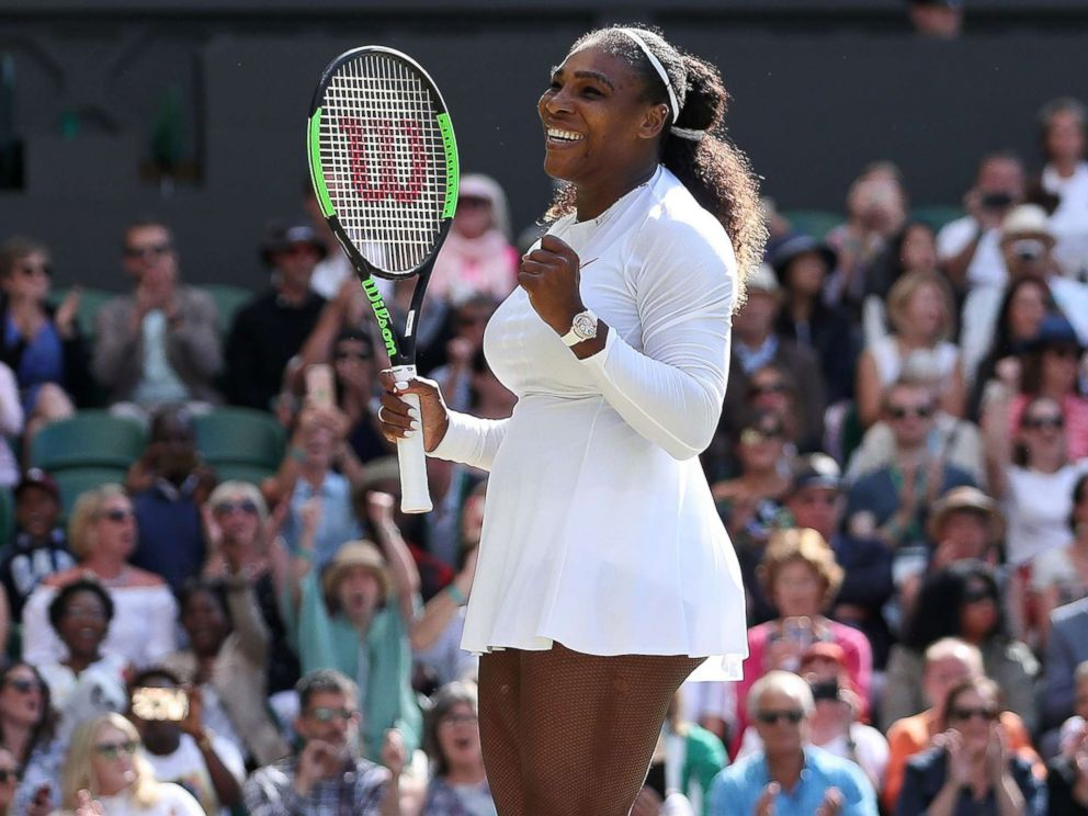 PHOTO: Serena Williams celebrates after winning against Italys Camila Giorgi during their womens singles quarter-final match on the eighth day of the 2018 Wimbledon Championships at The All England Lawn Tennis Club in Wimbledon, London, July 10, 2018.