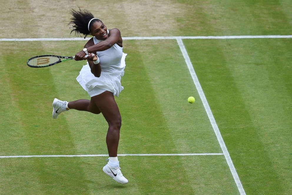 PHOTO: Serena Williams returns against Germanys Angelique Kerber during the womens singles final on the thirteenth day of the 2016 Wimbledon Championships at The All England Lawn Tennis Club in Wimbledon, southwest London, on July 9, 2016.